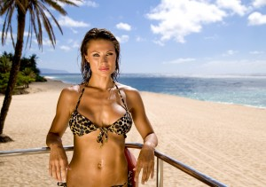 beautiful-woman-at-beach-has-online-backup-service-protecting-her-data